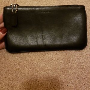 Coach black leather case.